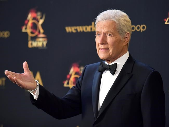FILE - In this May 5, 2019, file photo Alex Trebek poses in the press room at the 46th annual Daytime Emmy Awards at the Pasadena Civic Center in Pasadena, Calif. Trebek said Tuesday, Sept. 17, that he's had a setback in his battle with pancreatic cancer and is undergoing chemotherapy again.(Photo by Richard Shotwell/Invision/AP, File)