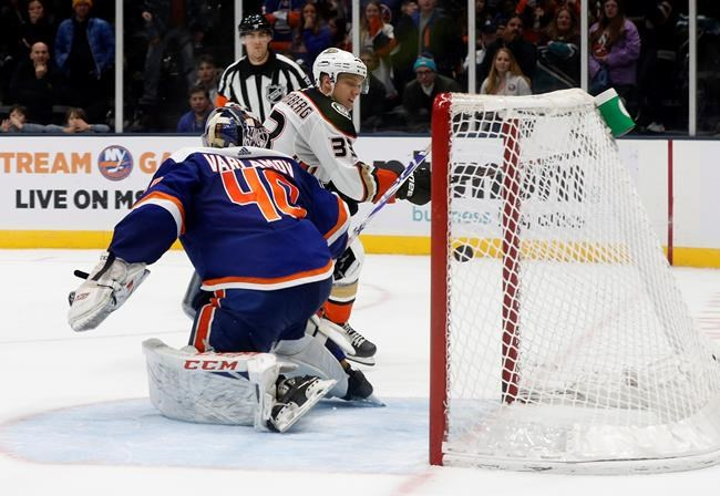 Anaheim Ducks right wing Jakob Silfverberg (33) puts the puck past New York Islanders goaltender Semyon Varlamov (40) for the game-winning goal during a shootout in their NHL hockey game, Saturday, Dec. 21, 2019, in Uniondale, N.Y. (AP Photo/Jim McIsaac)