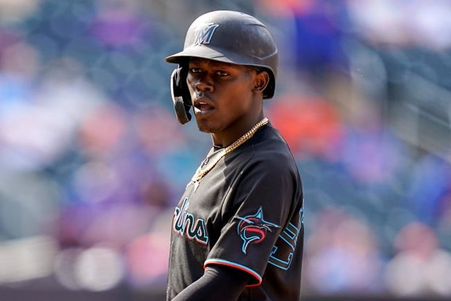Miami Marlins' Jazz Chisholm Jr. stands at first after being walked by New York Mets relief pitcher Edwin Diaz in the ninth inning of a baseball game, Saturday, April 10, 2021, in New York. (AP Photo/John Minchillo)
