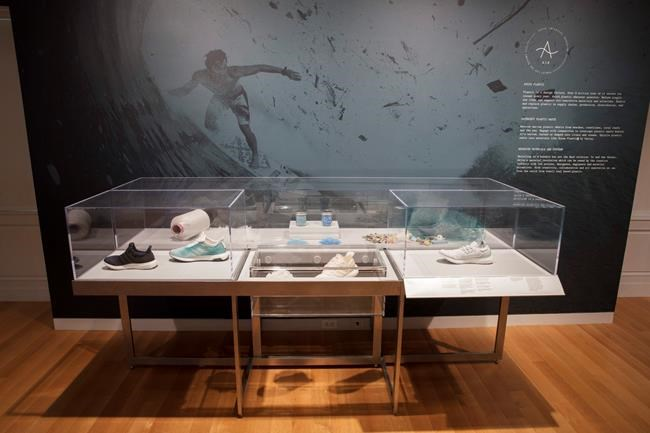 """This 2019 photo shows an Installation view of """"Nature—Cooper Hewitt Design Triennial"""" in New York. The exhibit of cutting edge innovations at the Cooper Hewitt, Smithsonian Design Museum, on view through January 20, 2020, includes a prototype for Adidas sneakers made of recycled ocean plastic and another prototype of sneakers that can be cleaned, broken down and remade entirely with the same material. (Matt Flynn/Cooper Hewitt, Smithsonian Design Museum via AP)"""