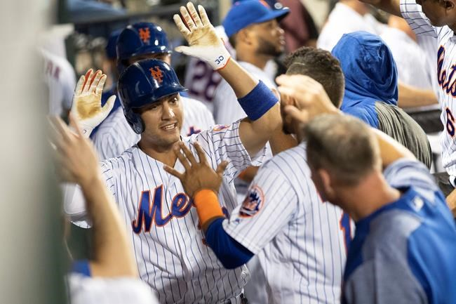 New York Mets' Michael Conforto (30) celebrates after hitting a home run during the sixth inning of a baseball game against the Cleveland Indians, Tuesday, Aug. 20, 2019, in New York. (AP Photo/Mary Altaffer)