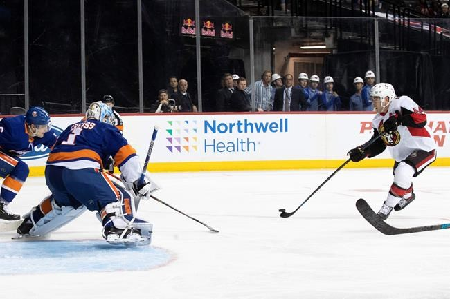 Ottawa Senators center Jean-Gabriel Pageau (44) shoots the puck to score a goal past New York Islanders goaltender Thomas Greiss (1) during the first period of an NHL hockey game, Tuesday, Nov. 5, 2019, in New York. (AP Photo/Mary Altaffer)