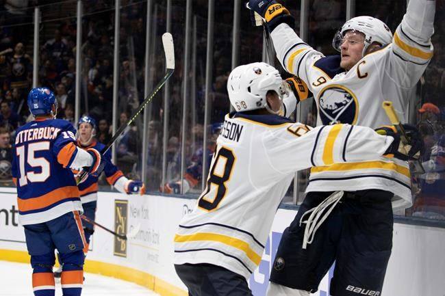 Buffalo Sabres center Jack Eichel (9) celebrates his third period goal with left wing Victor Olofsson (68) during an NHL hockey game, Saturday, Dec. 14, 2019 in Uniondale, N.Y. The Islanders won 3-2 in overtime. (AP Photo/Mark Lennihan)