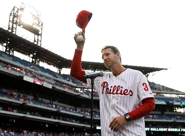 Former Philadelphia Phillies' Roy Halladay acknowledges the crowd before a 2014 baseball game against the New York Mets. (Matt Slocum / The Associated Press files)