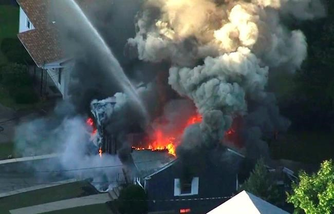 In this image take from video provided by WCVB in Boston, flames consume the roof of a home in Lawrence, Mass, a suburb of Boston, Thursday, Sept. 13, 2018. Emergency crews are responding to what they believe is a series of gas explosions that have damaged homes across three communities north of Boston. (WCVB via AP)