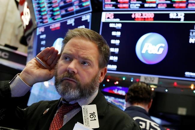 Trader Thomas McCauley works on the floor of the New York Stock Exchange, Thursday, Dec. 6, 2018. U.S. stocks tumbled in early trading Thursday following a sell-off in overseas markets. (AP Photo/Richard Drew)