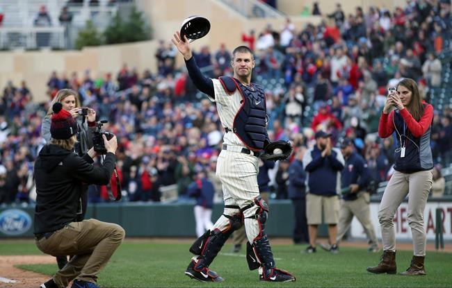 FILE - In this Sunday, Sept. 30, 2018, file photo, Minnesota Twins' Joe Mauer dons catcher's gear to catch for a pitch against a Chicago White Sox batter in the ninth inning of a baseball game, in Minneapolis. Mauer began his career as a catcher before switching to first base. The Minneapolis Star Tribune reports that Mauer has taken out an ad in its Sunday, Nov. 11, 2018, paper to announce his retirement. (AP Photo/Jim Mone, File)