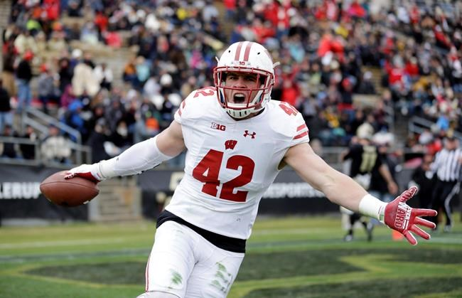 T.J. Watt celebrating after returning an interception for a touchdown during the first half of an NCAA college football game against the Purdue in West Lafayette Ind. Frame to grow int