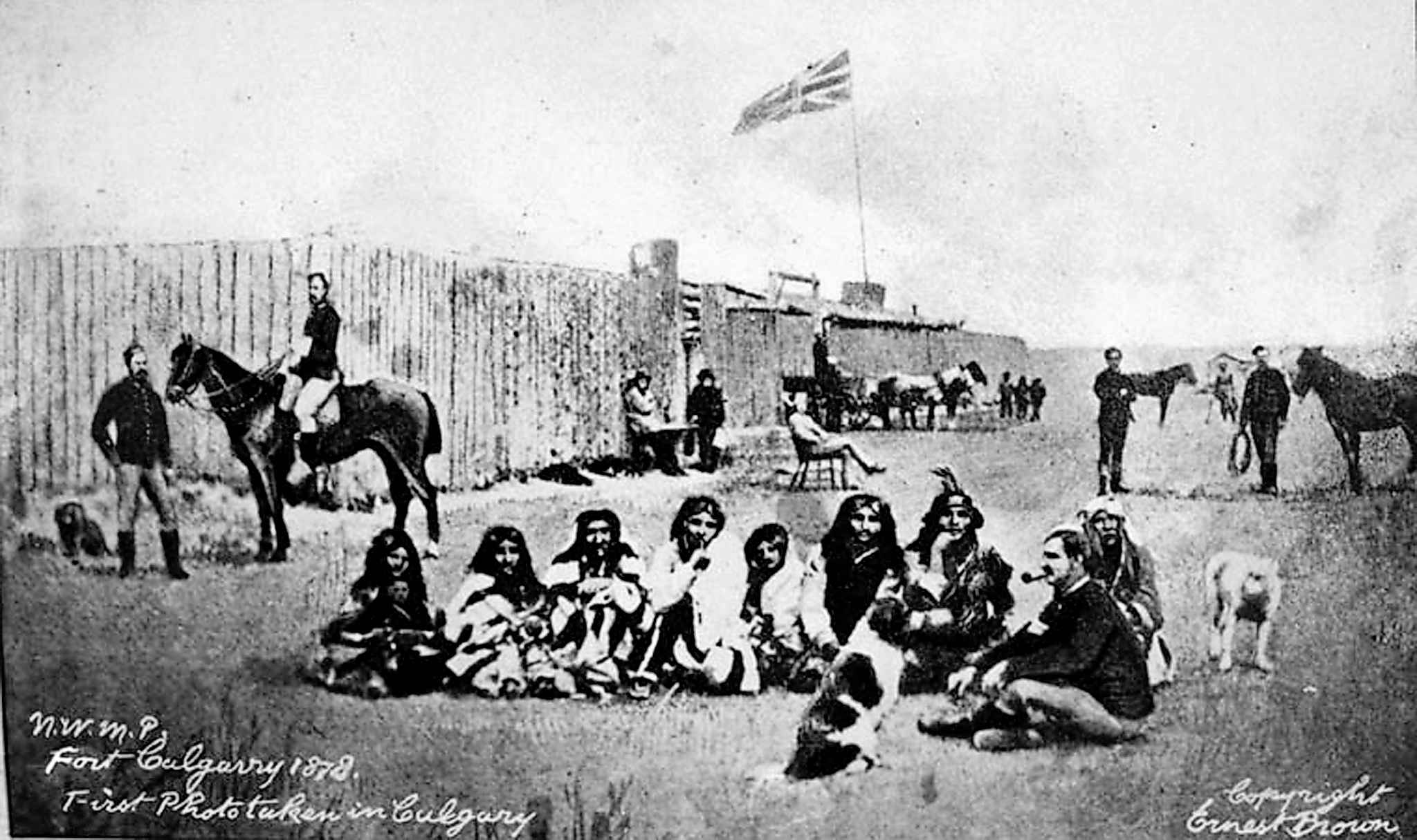 North-West Mounted police and members of the Blackfoot First Nation at Fort Calgary, 1878. (Library and Archives Canada)