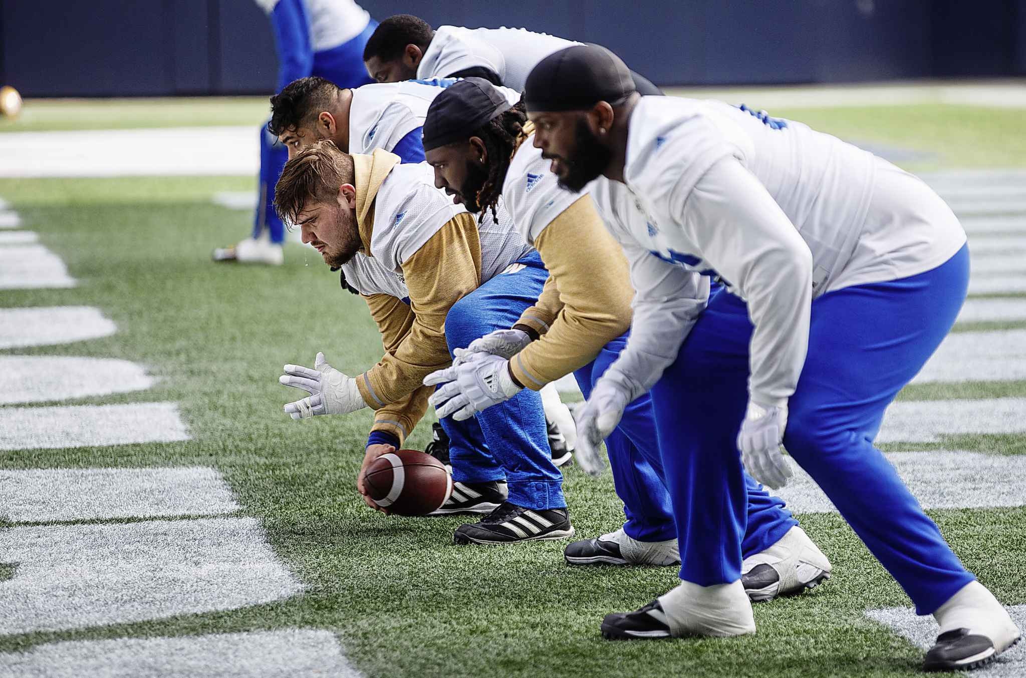 Winnipeg Blue Bombers centre Matthias Goossen, with ball, and the rest of the O-line are looking to return to form as one of the best units in the league this season.
