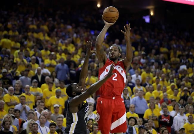 Toronto Raptors' Kawhi Leonard, right, shoots over Golden State Warriors' Draymond Green in  Game 6 of basketball's NBA Finals. (Ben Margot / The Associated Press)