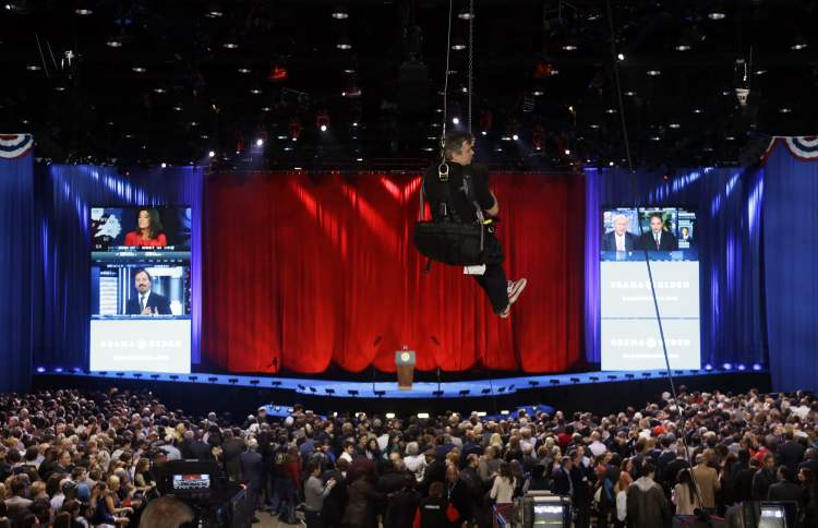 A rigger makes his way up top the rafters during the election night party for President Barack Obama Tuesday, in Chicago.  (Chris Carlson / The Associated Press)