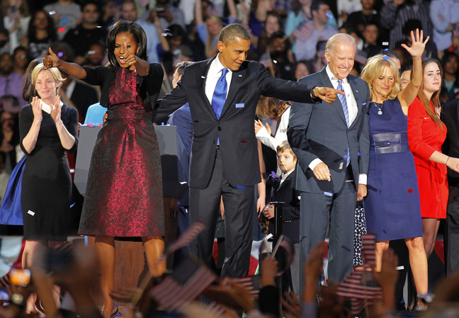 President Barack Obama, joined by  his wife Michelle, Vice-President Joe Biden and his spouse  Jill acknowledge applause  after Obama delivered his victory speech to supporters gathered in Chicago early Wednesday. (Jerome Delay / The Associated Press)