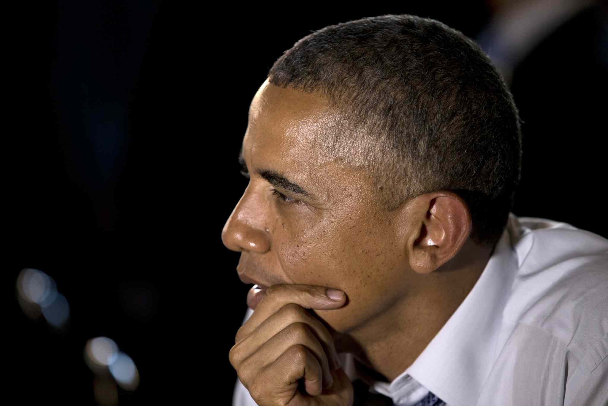 President Barack Obama listens as he meets with five people who wrote him letters at Wazee Supper Club on July 8 in Denver.