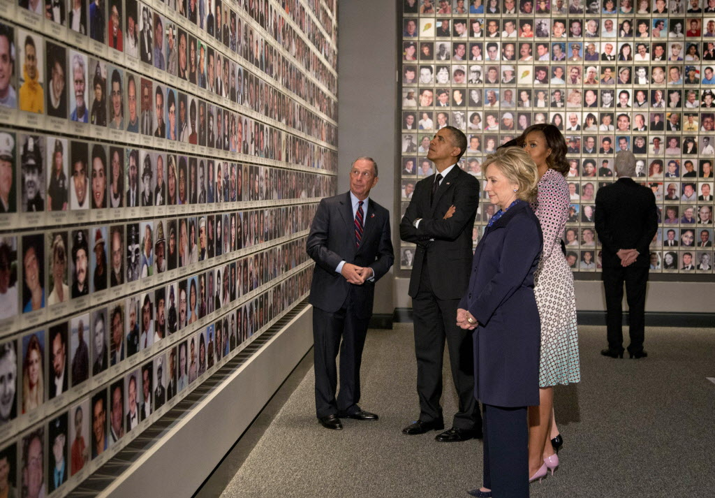 President Barack Obama and first lady Michelle Obama, along with former Secretary of State Hillary Rodham Clinton and former President Bill Clinton tour the Memorial Hall at the National September 11 Memorial Museum with former New York Mayor Michael Bloomberg.