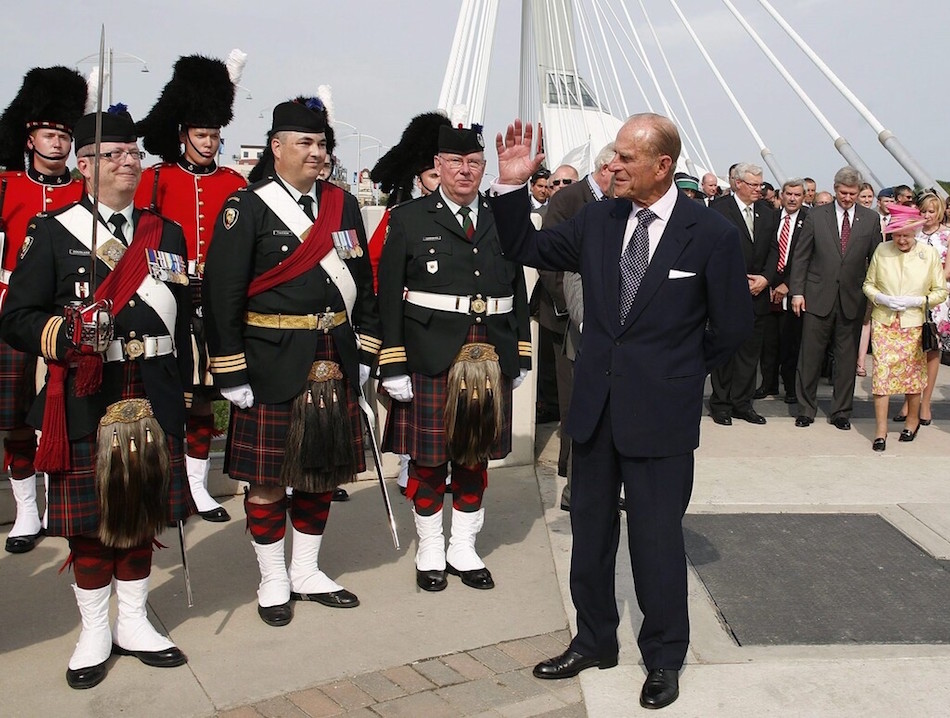 Prince Philip greets a contingent of The Queen's Own Cameron Highlanders as Queen Elizabeth II is escorted by prime minister Stephen Harper on the Esplanade Riel during a visit in Winnipeg on July 3, 2010.  (John Woods / The Canadian Press files) - CP