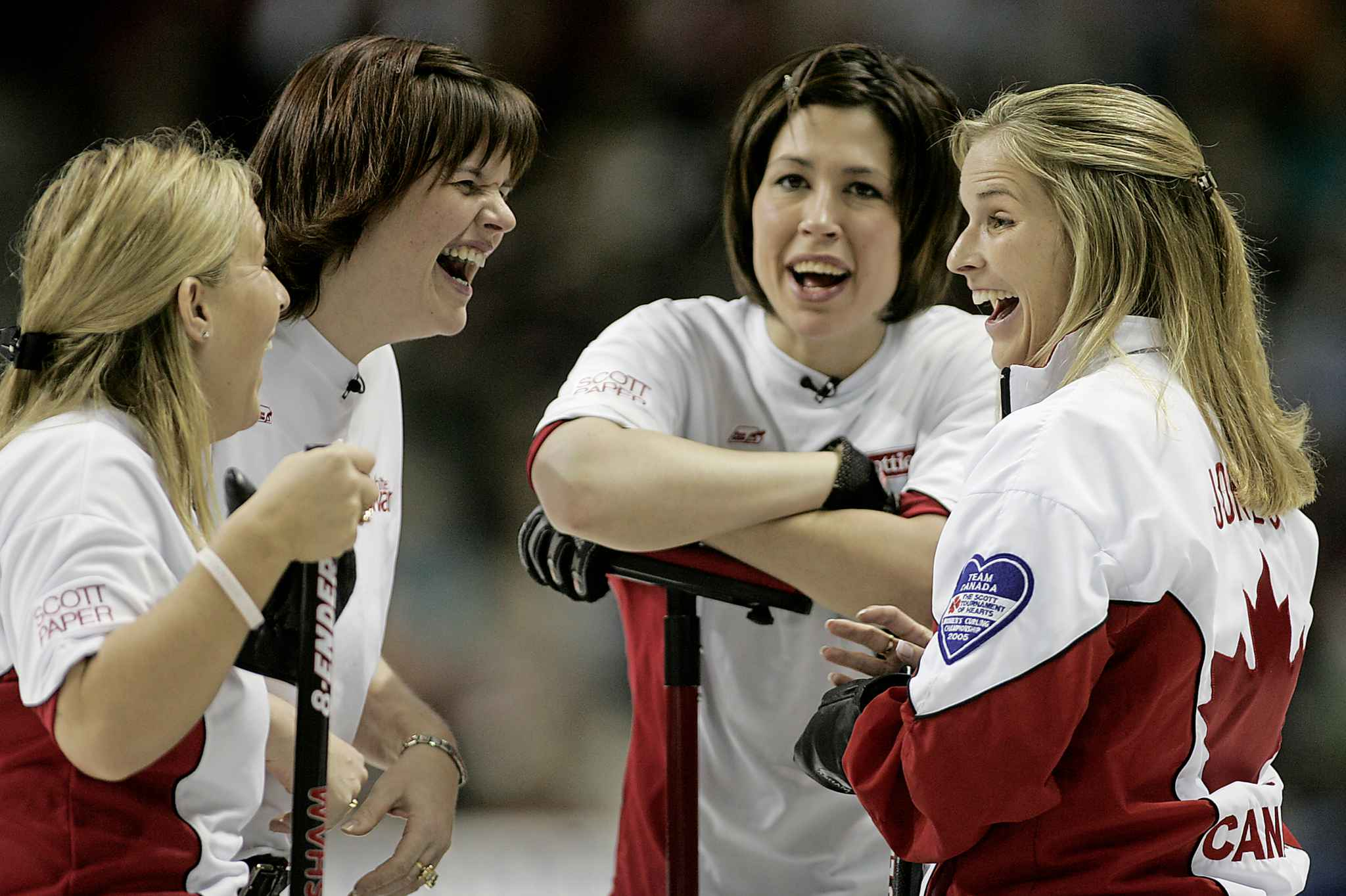 Cathy Overton-Clapham (left), Georgina Wheatcroft, Jill Officer and skip Jennifer Jones (right) share a laugh during the Canadian womens curling championships in 2006.