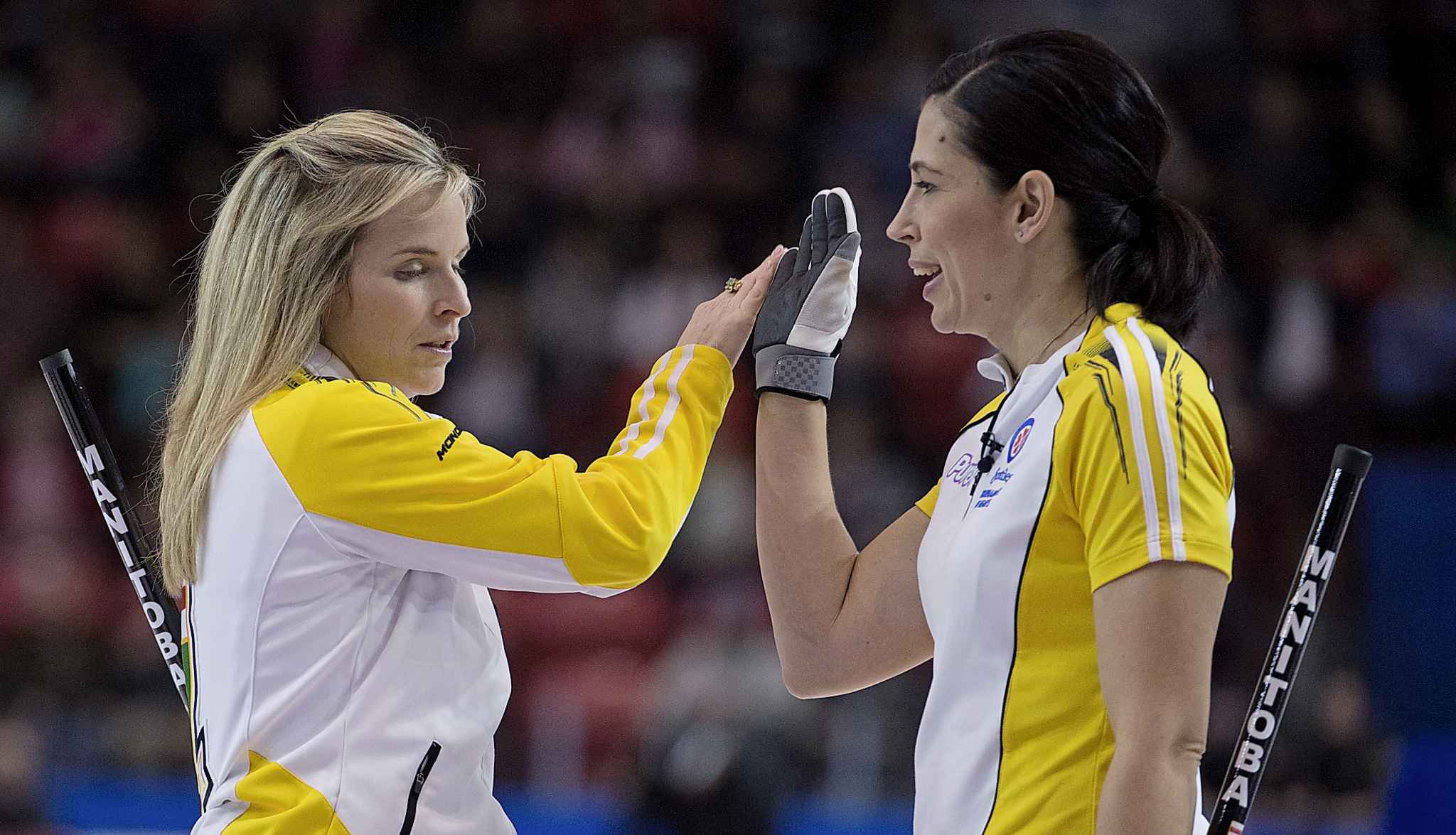Jones gives a high five to Officer during the Scotties Tournament of Hearts in Moose Jaw in 2015.