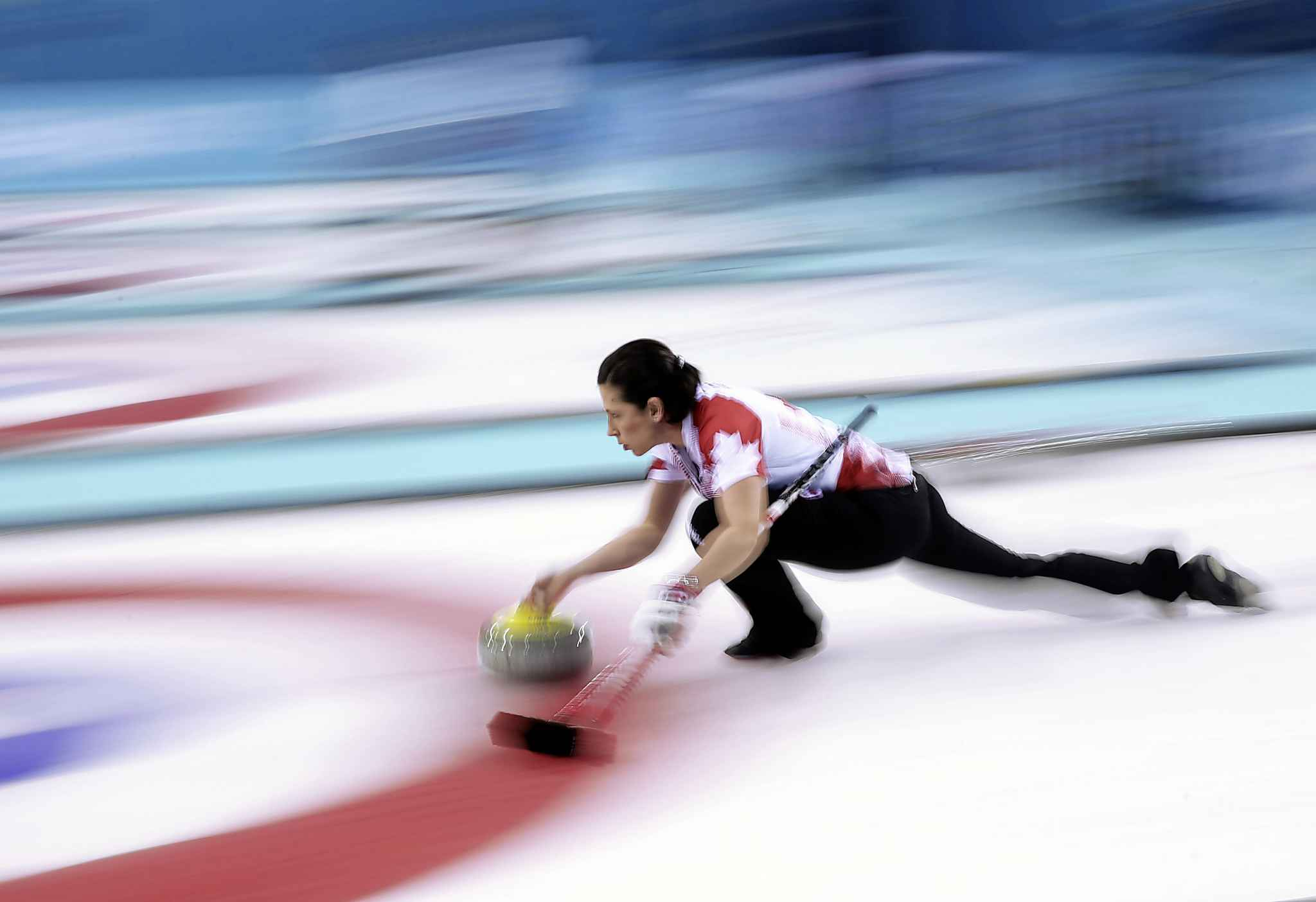 Canada's Jill Officer throws against Great Britain during women's curling semifinals at the Ice Cube Curling Center during the Winter Olympics in Sochi, Russia, Wednesday, Feb. 19, 2014. (Brian Cassella/Chicago Tribune/MCT) TRIBUNE MEDIA MCT