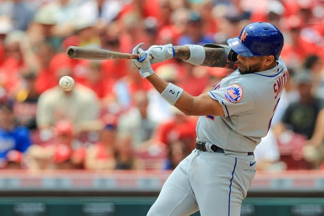 New York Mets' Dominic Smith hits a single during the fourth inning of a baseball game against the Cincinnati Reds in Cincinnati, Wednesday, July 21, 2021. (AP Photo/Aaron Doster)