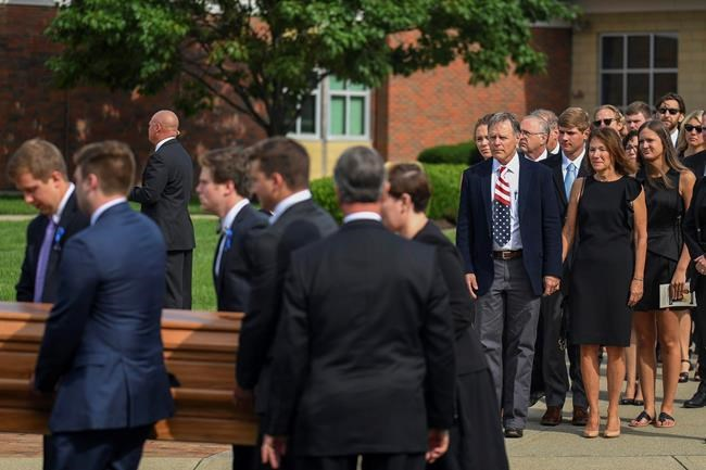 Thousands of mourners bid farewell to Warmbier