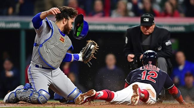 Toronto Blue Jays' Russell Martin tags out Cleveland Indians' Francisco Lindor during the sixth inning of a baseball game Friday, April 13, 2018, in Cleveland. (AP Photo/David Dermer)