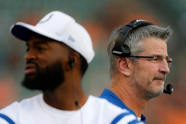 Indianapolis Colts coach Frank Reich, right, stands near quarterback Jacoby Brissett during the first half of the team's NFL preseason football game against the Cincinnati Bengals, Thursday, Aug. 29, 2019, in Cincinnati. (AP Photo/Gary Landers)