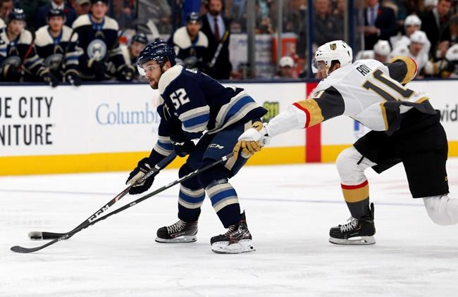 Columbus Blue Jackets forward Emil Bemstrom, left, of Sweden, controls the puck in front of Vegas Golden Knights forward Nicolas Roy during the second period of an NHL hockey game in Columbus, Ohio, Tuesday, Nov. 5, 2019. (AP Photo/Paul Vernon)