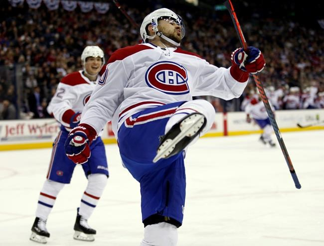 Montreal Canadiens forward Tomas Tatar, right, of Slovakia, celebrates his goal against the Columbus Blue Jackets in front of teammate forward Artturi Lehkonen, of Finland, during the first period of an NHL hockey game in Columbus, Ohio, Friday, Jan. 18, 2019. The Canadiens won 4-1. (AP Photo/Paul Vernon)