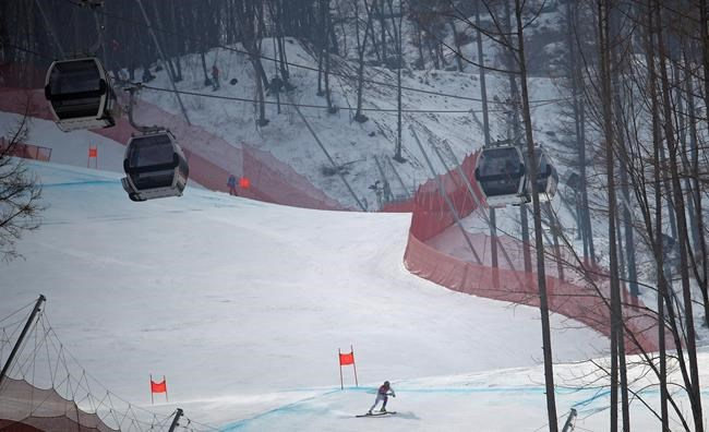Serbia's Marko Vukicevic speeds down the course in men's downhill training at the 2018 Winter Olympics in Jeongseon, South Korea, Friday, Feb. 9, 2018. (AP Photo/Christophe Ena)
