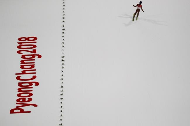 Kamil Stoch, of Poland, finishes his jump during the men's normal hill individual ski jumping trial round for qualification ahead of the 2018 Winter Olympics in Pyeongchang, South Korea, Thursday, Feb. 8, 2018. (AP Photo/Matthias Schrader)