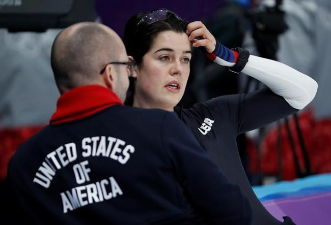 Carlijn Schoutens of the United States, right, speaks with a team member during a speed skating training session prior to the 2018 Winter Olympics in Gangneung, South Korea, Friday, Feb. 9, 2018. (AP Photo/John Locher)