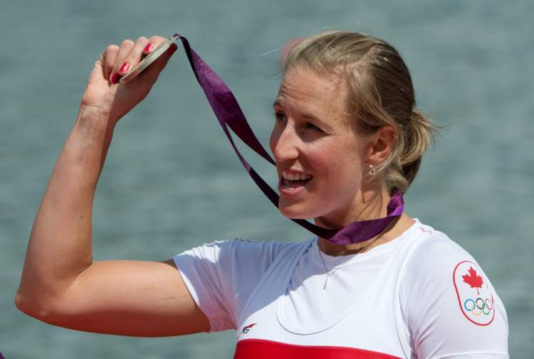 Winnipeg's Janine Hanson shows the silver medal she won as a member of Canada's women's eight rowing team.
