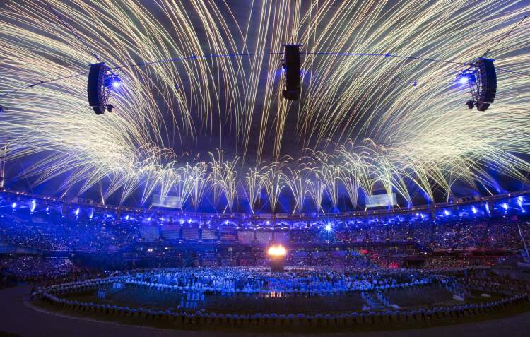 Fireworks illuminate the stadium after the lighting of the Olympic flame at the 2012 Olympic Games opening ceremonies in London on Friday. (Frank Gunn / The Canadian Press)