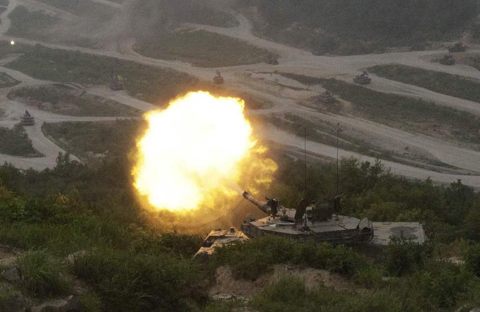 A South Korean army K1A1 tank fires during South Korea-U.S. joint military live-fire drills at Seungjin Fire Training Field in Pocheon, South Korea, near the border with North Korea. (AP Photo/Ahn Young-joon)