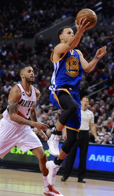 Golden State Warriors' Stephen Curry (30) shoots against Portland Trail Blazers' Allen Crabbe (23) during the first half of an NBA basketball game in Portland, Ore., Tuesday, March 24, 2015. (AP Photo/Greg Wahl-Stephens)
