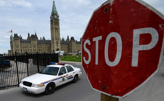 An RCMP cruiser drives past a stop sign on Parliament Hill in Ottawa on Thursday, June 13, 2013. THE CANADIAN PRESS/Sean Kilpatrick