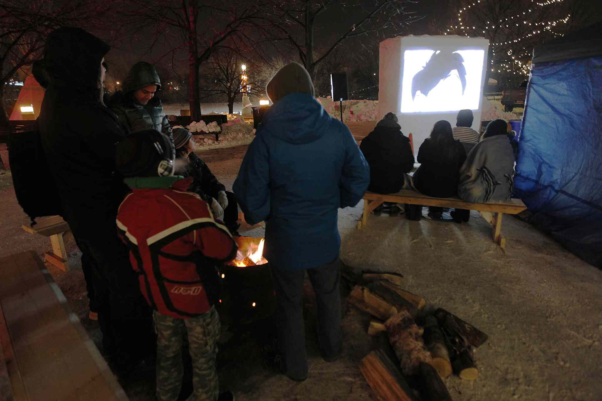 People enjoy a free outdoor screening of eight short films during the sixth annual Canadian Sport Film Festival at The Forks Saturday.