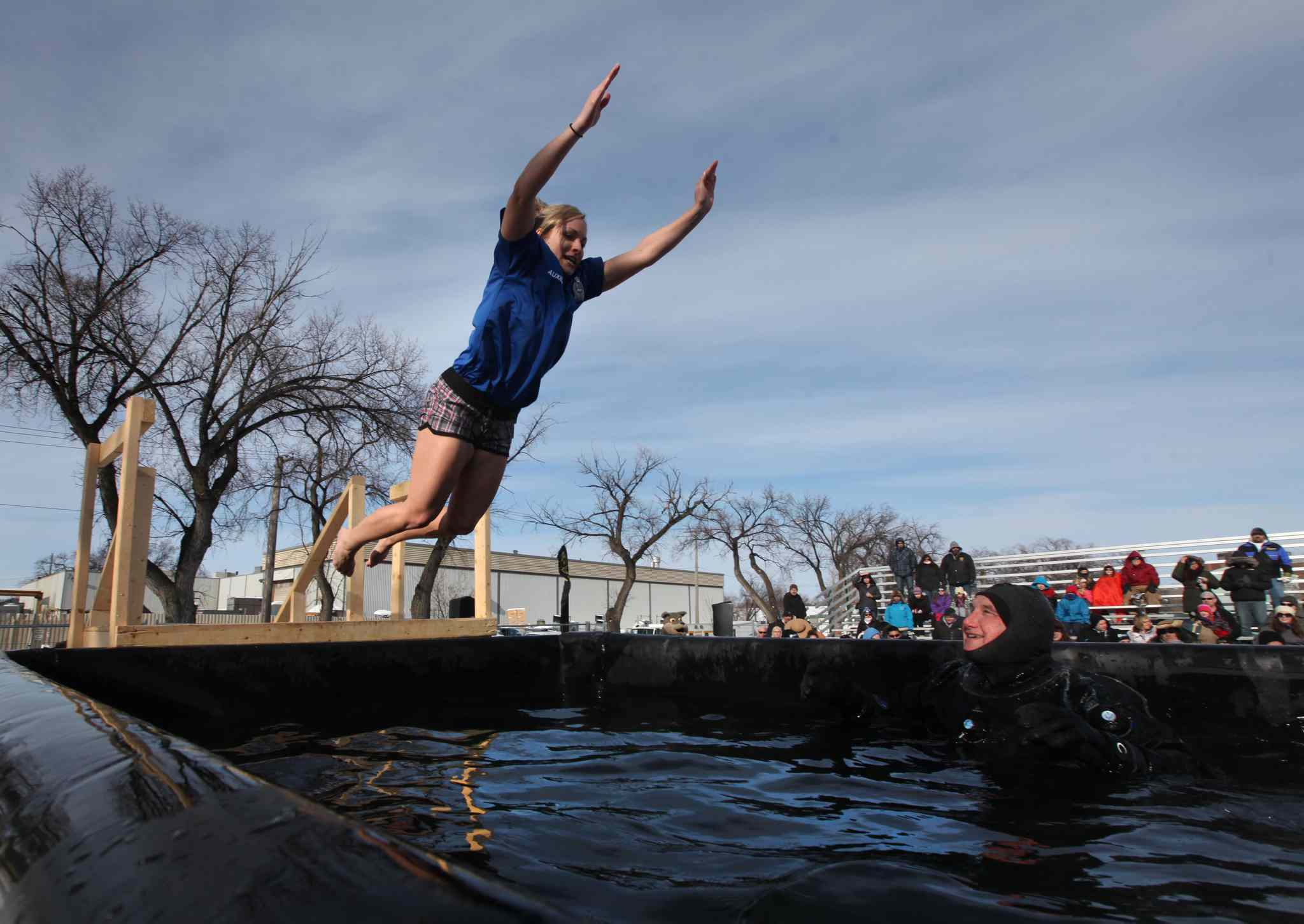A contestant screams as she braces herself before jumping into the cold water at the Friendship Centre Saturday.