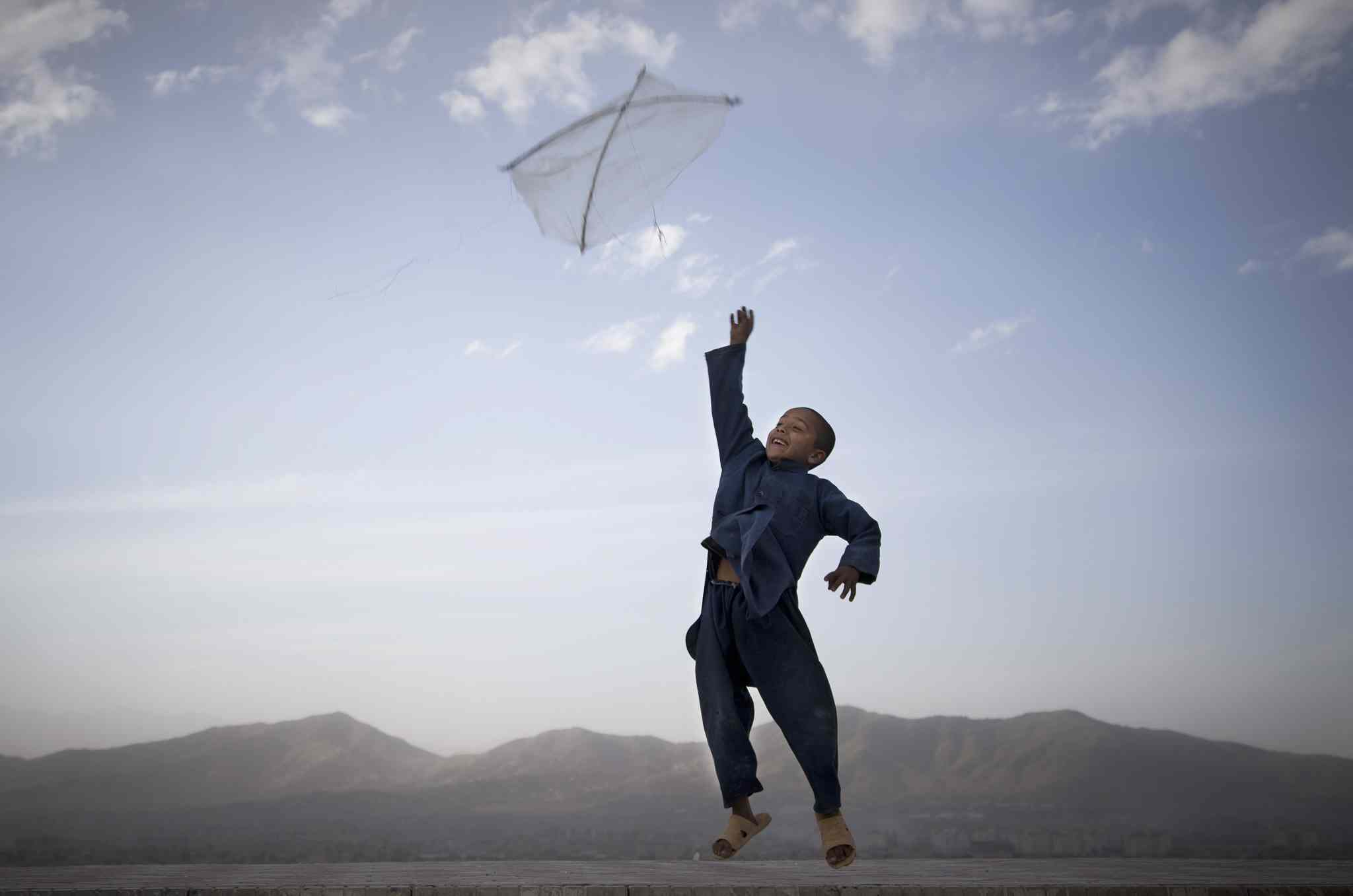 May 13, 2013: An Afghan boy flies his kite on a hill overlooking Kabul, Afghanistan.