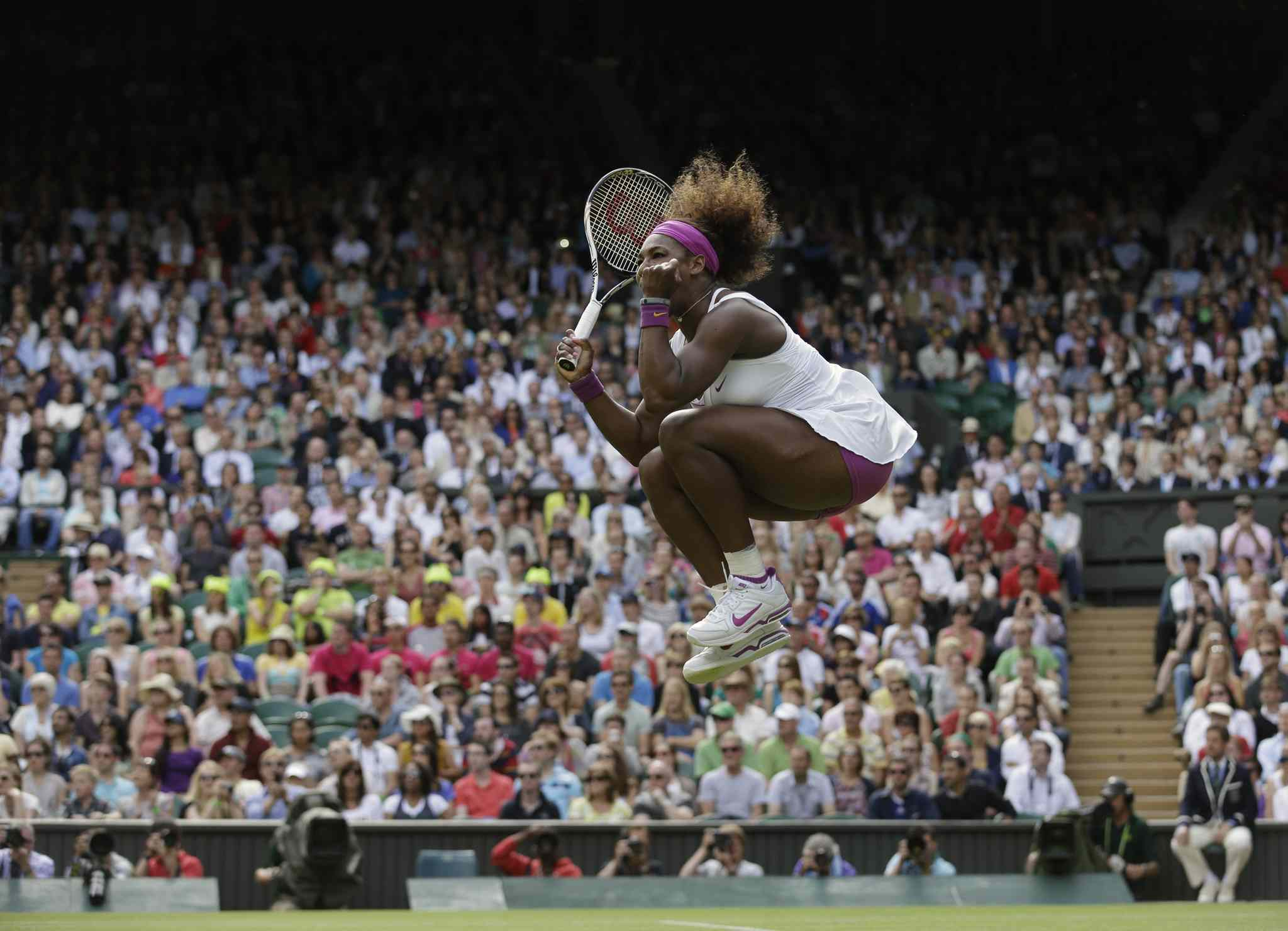 June 30, 2012: - Serena Williams of the United States reacts after winning against Zheng Jie of China during a third round women's singles match at the All England Lawn Tennis Championships at Wimbledon, England.