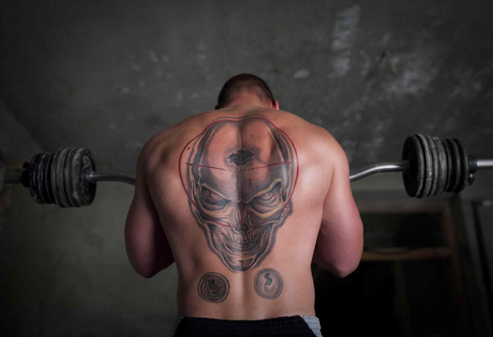 Sept, 17, 2011: A German soldier lifts weights at his combat outpost in Char Darah, outside Kunduz, Afghanistan.