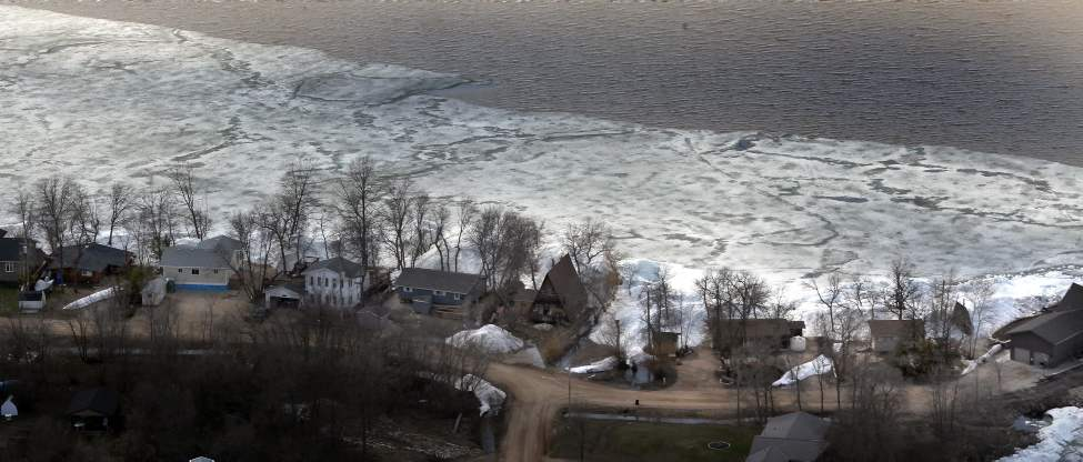 Specific factors must be in place for an ice shove. First, ice floating on a large body of water that's in the process of thawing. While solid sheets won't move, any form of free-floating ice -- large blocks or smaller shards -- can be pushed around by wind. (Phil Hossack / Winnipeg Free Press)