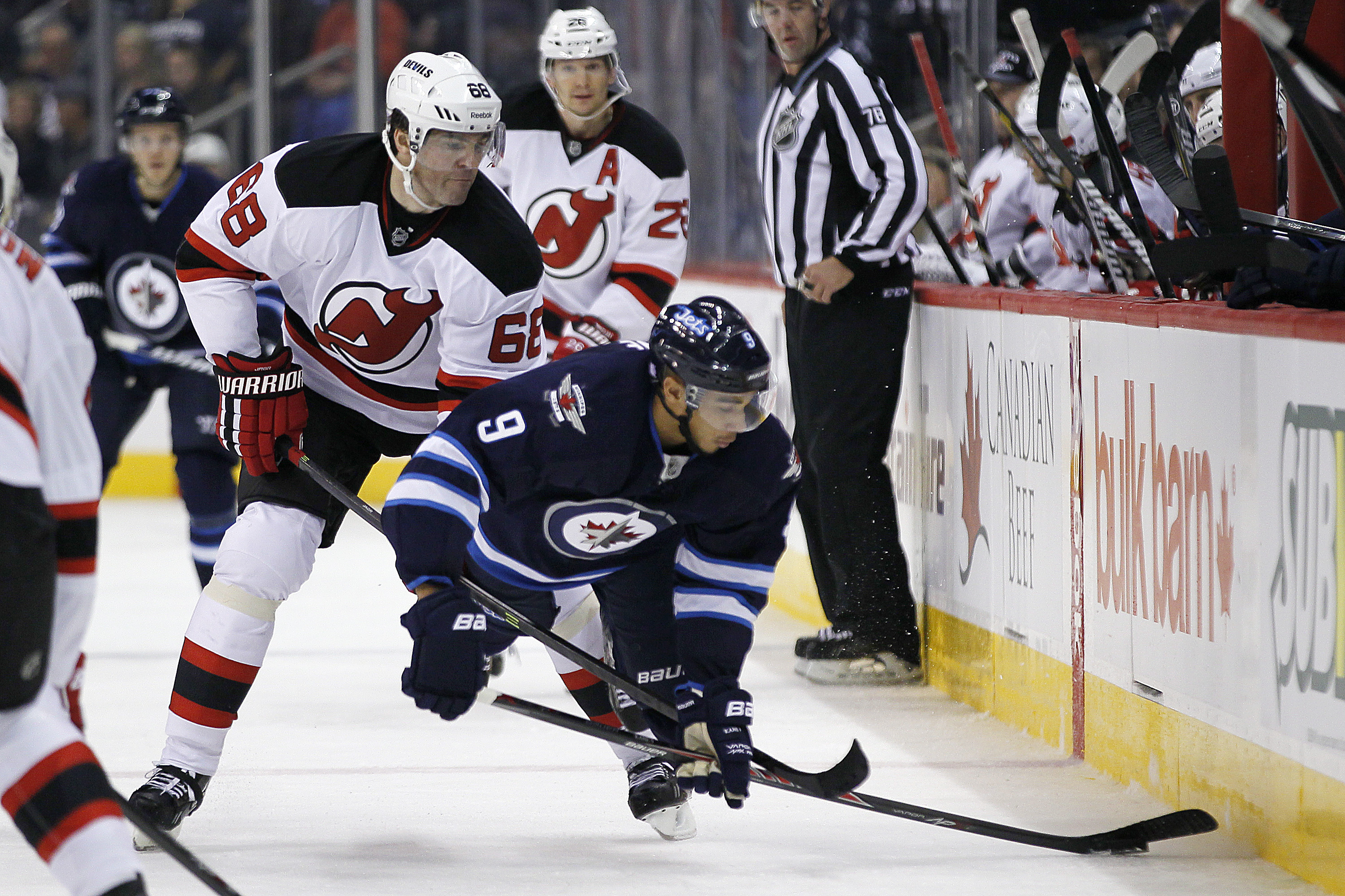 Evander Kane is tripped by Jaromir Jagr during the second period.
