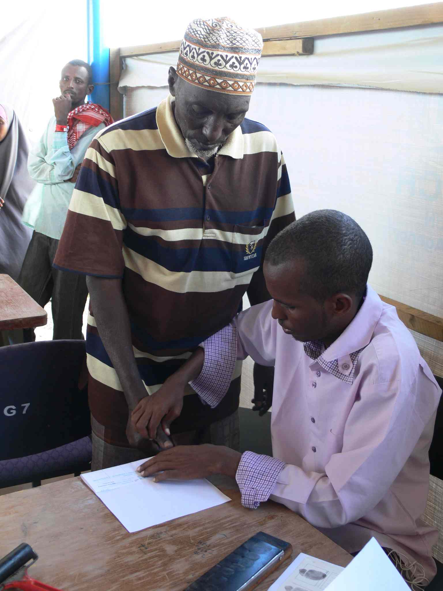 Refugees registering at Ifo 2 camp in Dadaab are finger printed the old-fashioned way during security screening. The Kenyan government  requires the finger prints for security reasons.