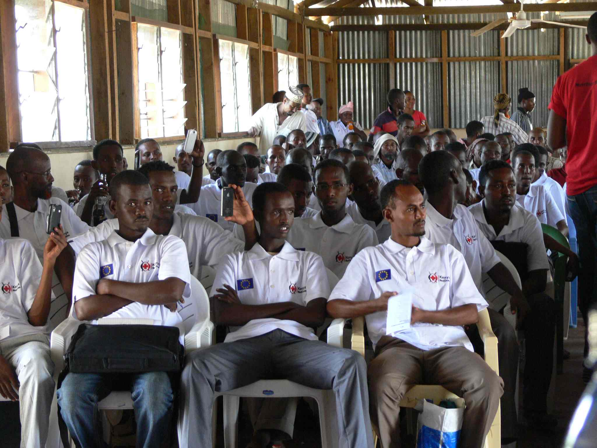 Graduation day for 60 students in the 20-week reproductive and preventive health program put on by the Kenyan Red Cross. The men and women who are refugees will work in their communities to promote health care. The men completed the 'champions for reproductive health' program.