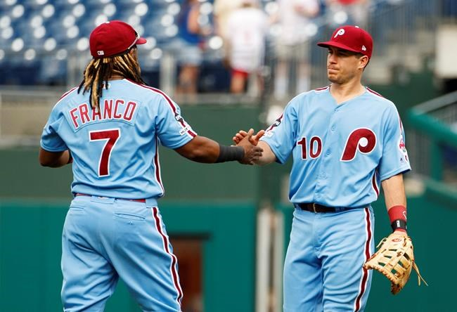 Philadelphia Phillies' J.T. Realmuto, right, celebrates the win with Maikel Franco, left, following the ninth inning of a baseball game against the San Francisco Giants, Thursday, Aug. 1, 2019, in Philadelphia. Phillies won 10-2. (AP Photo/Chris Szagola)
