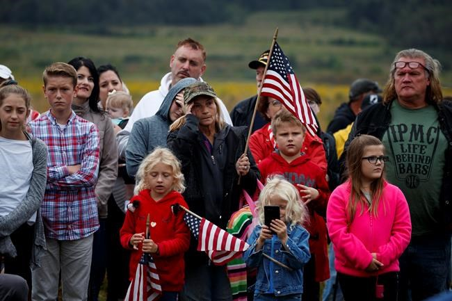 People look on during the September 11th Flight 93 Memorial Service, Tuesday, Sept. 11, 2018, in Shanksville, Pa. (AP Photo/Evan Vucci)