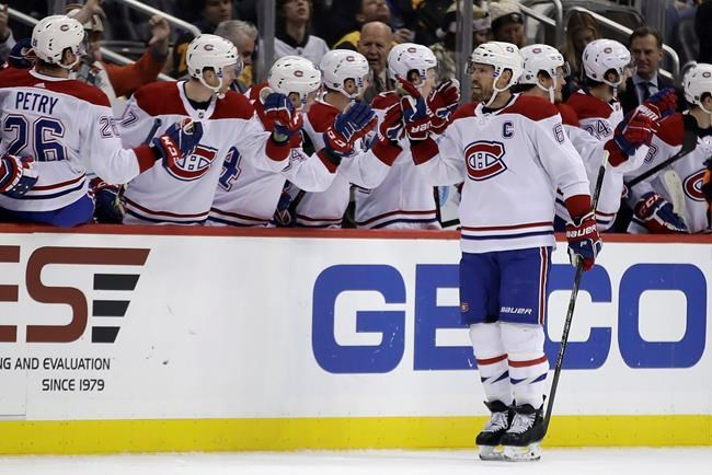 Montreal Canadiens' Shea Weber (6) returns to the bench after scoring during the second period of an NHL hockey game against the Pittsburgh Penguins in Pittsburgh, Tuesday, Dec. 10, 2019. (AP Photo/Gene J. Puskar)