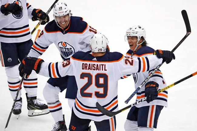 Edmonton Oilers' Leon Draisaitl (29) celebrates his game-winning goal, with James Neal (18) and Ethan Bear, right, during the overtime period of an NHL hockey game against the Pittsburgh Penguins in Pittsburgh, Saturday, Nov. 2, 2019. The Oilers won 2-1. (AP Photo/Gene J. Puskar)